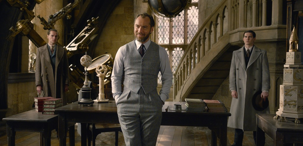 """This image released by Warner Bros. Pictures shows Jude Law in a scene from """"Fantastic Beasts: The Crimes of Grindelwald."""" (Warner Bros. Pictures via ..."""