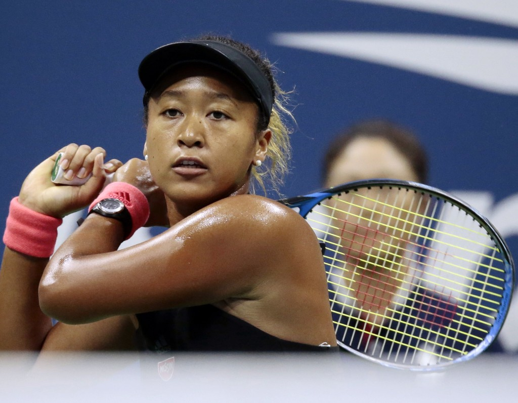FILE - In this Sept. 8, 2018, file photo, Naomi Osaka, of Japan, returns a shot to Serena Williams fo the U.S. during the women's final of the U.S. Op