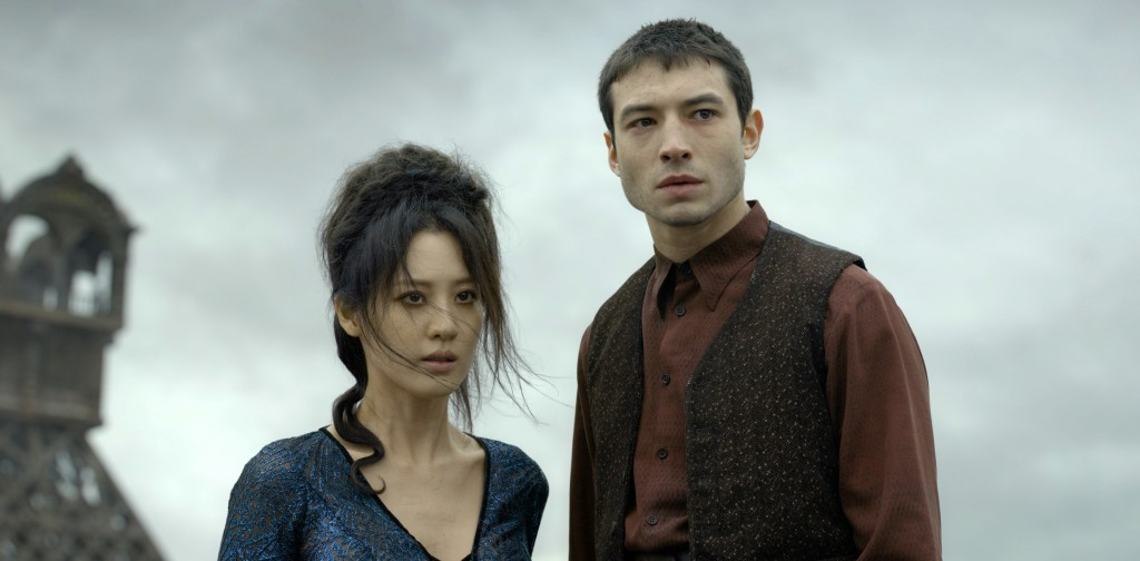 """This image released by Warner Bros. Pictures shows Claudia Kim, left and Ezra Millerin a scene from """"Fantastic Beasts: The Crimes of Grindelwald."""" (Ja..."""