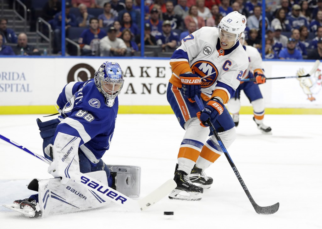 New York Islanders left wing Anders Lee (27) shoots wide of Tampa Bay Lightning goaltender Andrei Vasilevskiy (88) during the first period of an NHL h