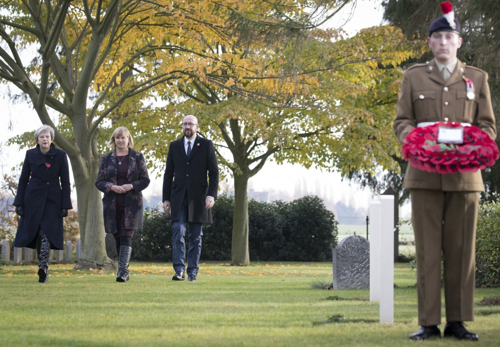 British Prime Minister Theresa May, left, and Belgian Prime Minister Charles Michel, second right, prepare to lay wreaths at the graves of British Wor...