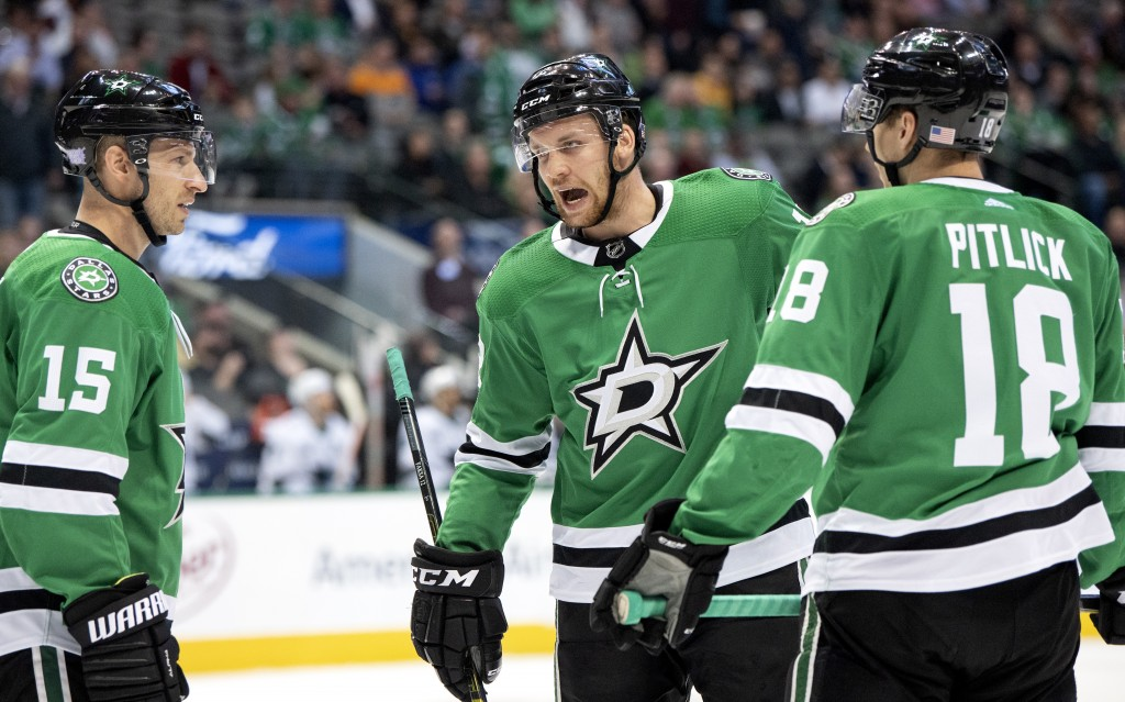Dallas Stars center Radek Faksa, center, of the Czech Republic, confers with Blake Comeau (15) and Tyler Pitlick (18) during the first period of an NH