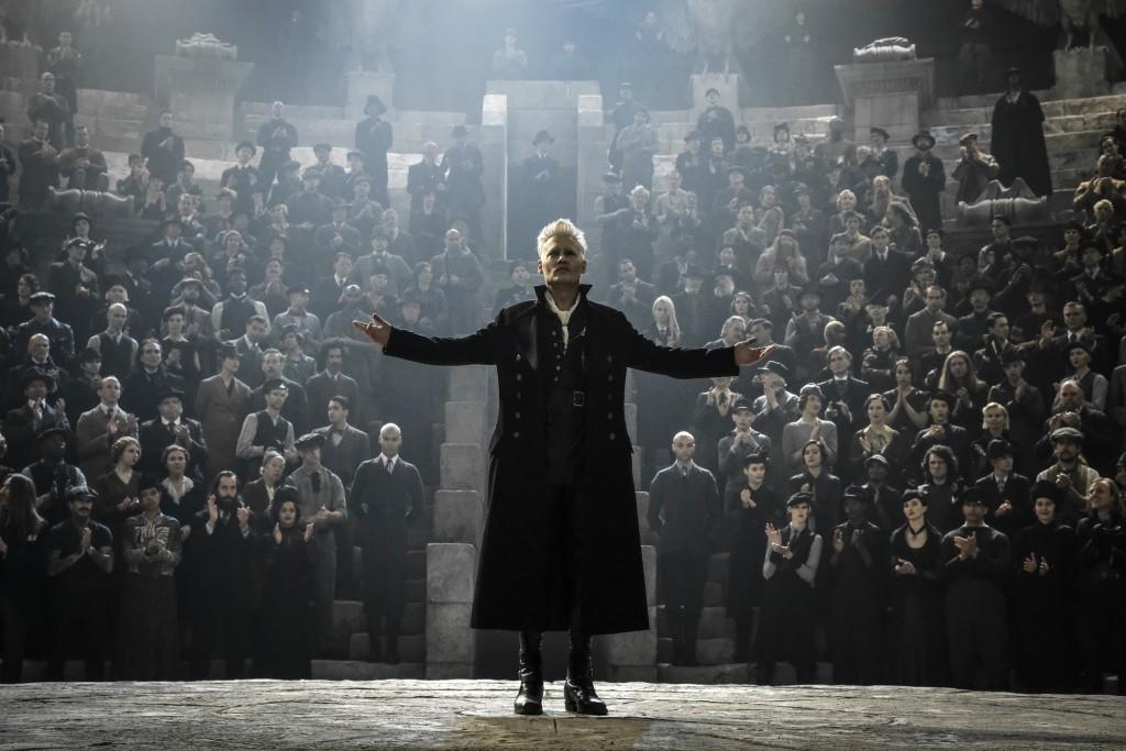 "This image released by Warner Bros. Pictures shows Johnny Depp in a scene from ""Fantastic Beasts: The Crimes of Grindelwald."" (Jaap Buitendijk/Warner ..."