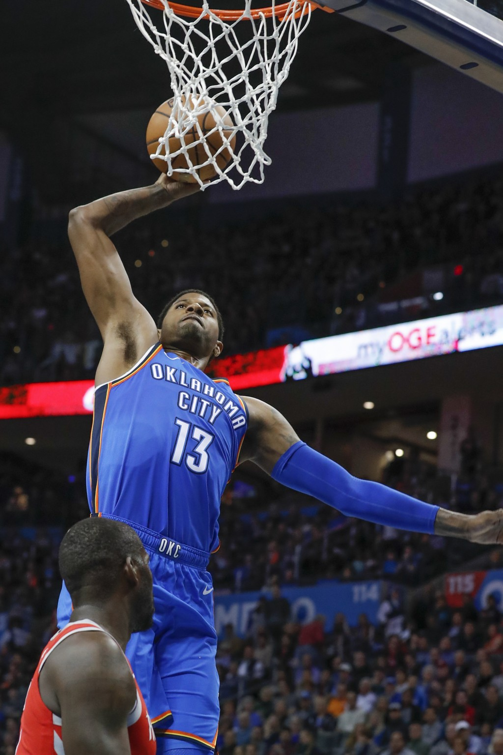 Oklahoma City Thunder forward Paul George (13) goes up for a dunk over Houston Rockets forward James Ennis III (8) during the first half of an NBA bas