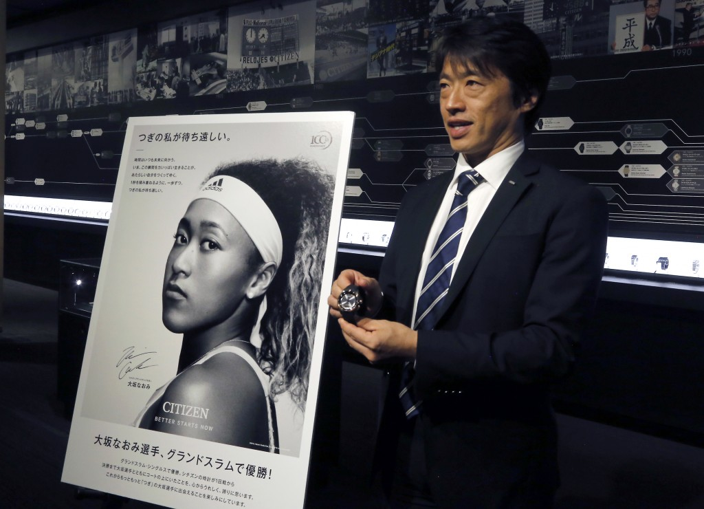 In this Oct. 24, 2018 photo, Shigeru Tanaka, advertising manager at Citizen, speaks while showing one of Naomi Osaka watches, which she wears during h