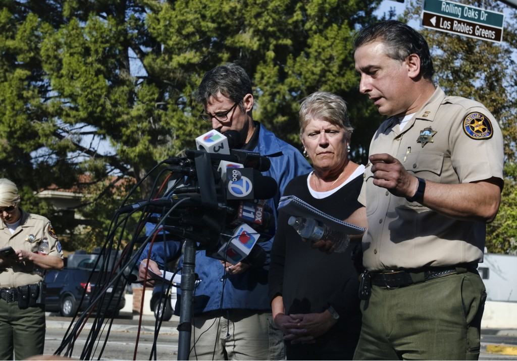 Standing at the microphones, from left to right, Paul Delacourt, assistant director for the FBI Los Angeles, and U.S. Rep. Julia Brownley look on as V