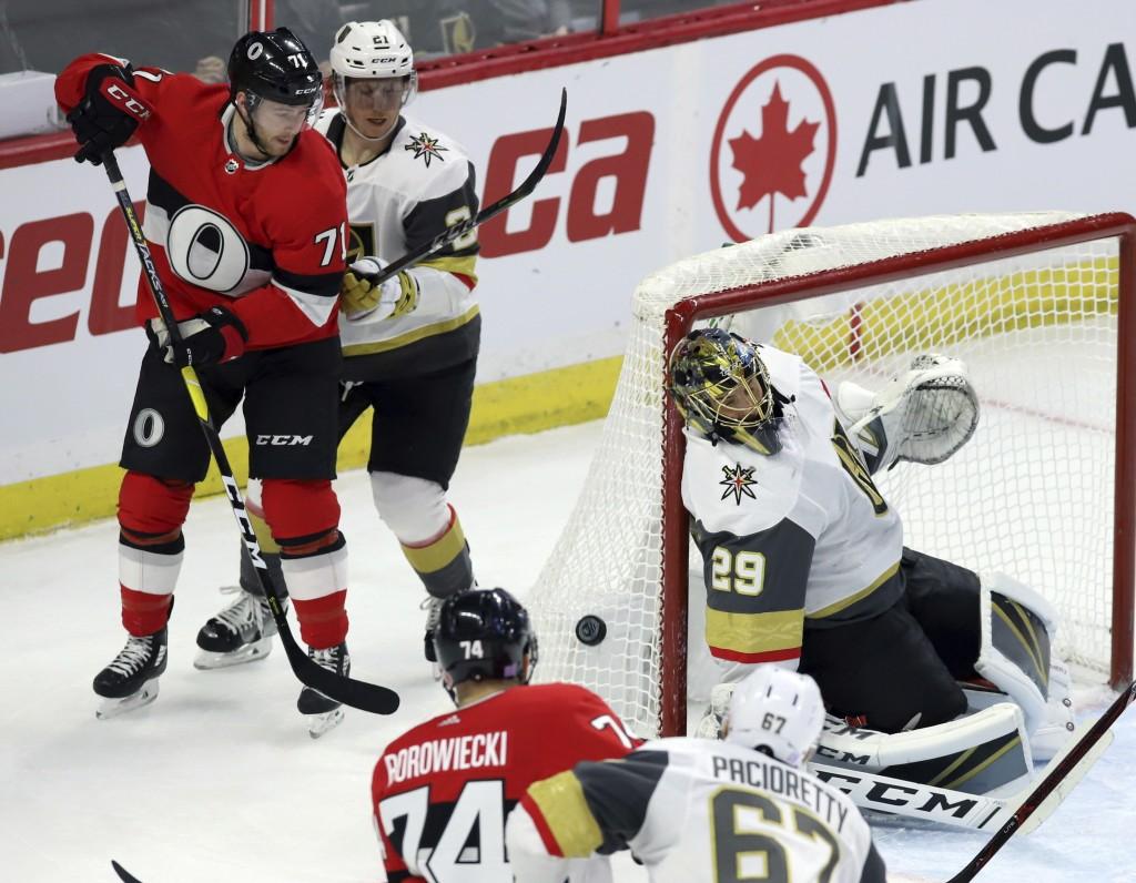 Ottawa Senators center Chris Tierney (71) and Vegas Golden Knights center Cody Eakin (21) look on as Vegas Golden Knights goaltender Marc-Andre Fleury