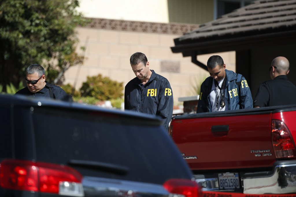 FBI agents leave the house of shooting suspect David Ian Long after conducting a search in Newbury Park, Calif., on Thursday, Nov. 8, 2018. Authoritie