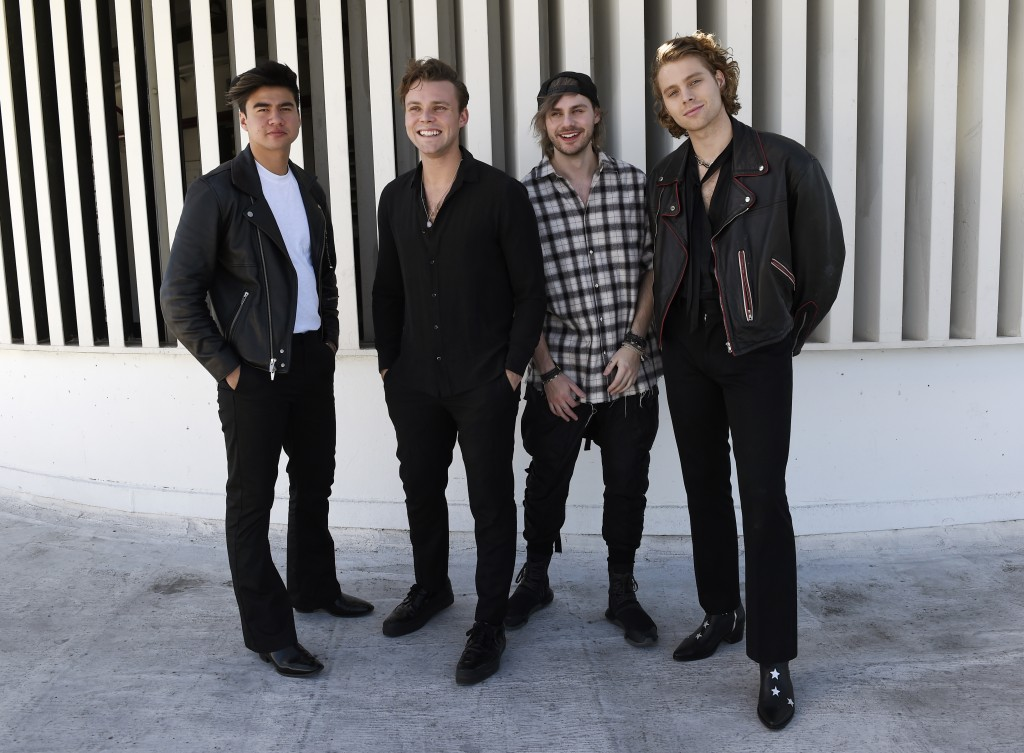 This Oct. 18, 2018 photo shows members of the band 5 Seconds of Summer, from left, Calum Hood, Ashton Irwin, Michael Clifford and Luke Hemmings posing