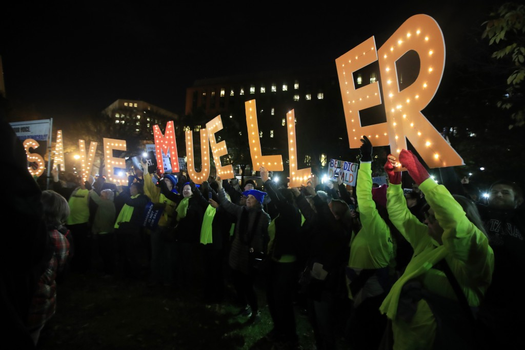 "Protesters gather and hold banners in front of the White House in Washington, Thursday, Nov. 8, 2018, as part of a nationwide ""Protect Mueller"" campai"