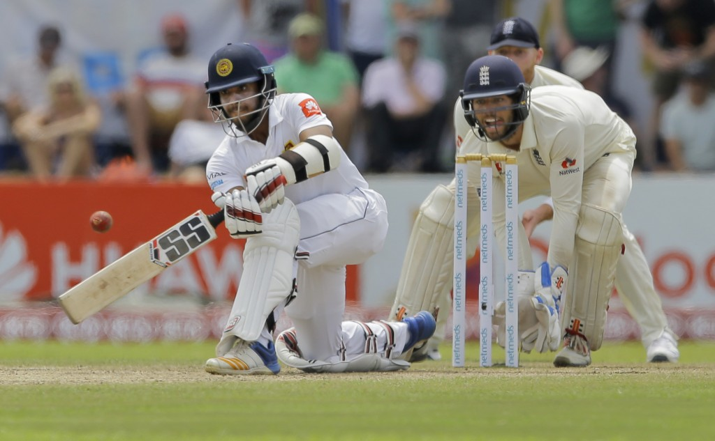 Sri Lanka's Kusal Mendis plays a shot as England's wicketkeeper Ben Foakes watches during the fourth day of the first test cricket match between Sri L