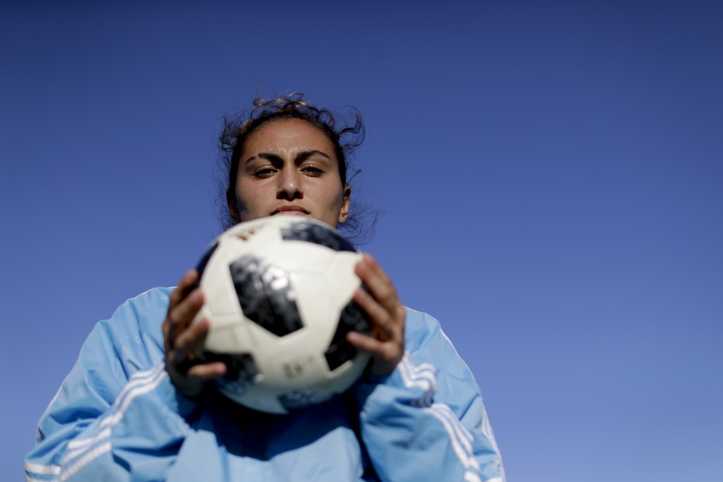 In this Nov. 1, 2018 photo, Argentina national female soccer player Luana Munoz poses for a photo at the Argentina Football Association, after a train