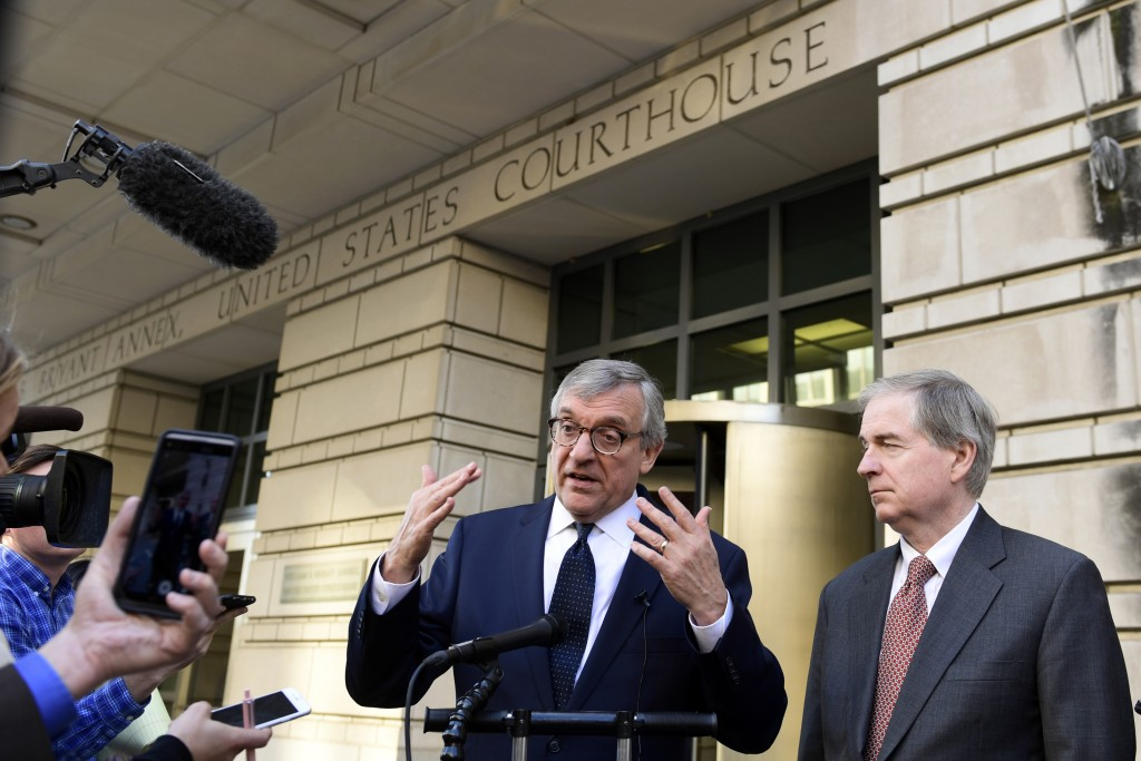Attorney Paul Kamenar, center, speaks to reporters outside federal court in Washington, Thursday, Nov. 8, 2018, as Peter Flaherty, right, Chairman and