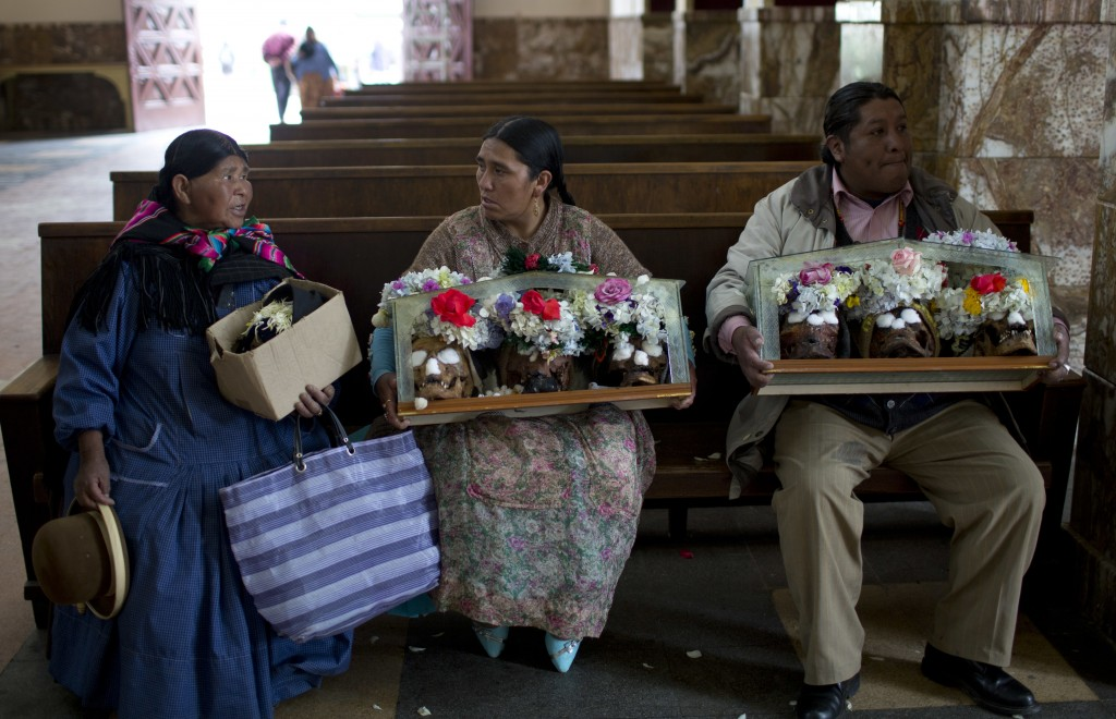 People hold their decorated humans skulls after attending a short service at the General Cemetery chapel marking the Natitas Festival in La Paz, Boliv...