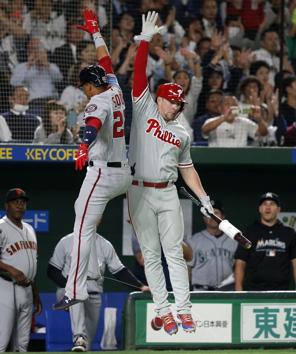 MLB All-Star left fielder Juan Soto, left, of the Washington Nationals celebrates with teammate Rhys Hoskins of the Philadelphia Phillies after hittin