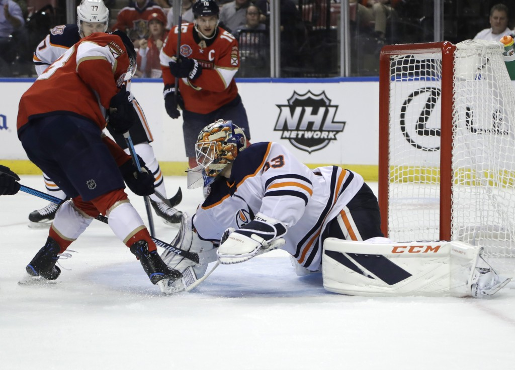 Florida Panthers right wing Evgenii Dadonov, left scores a goal past Edmonton Oilers goaltender Cam Talbot (33) during the second period of an NHL hoc