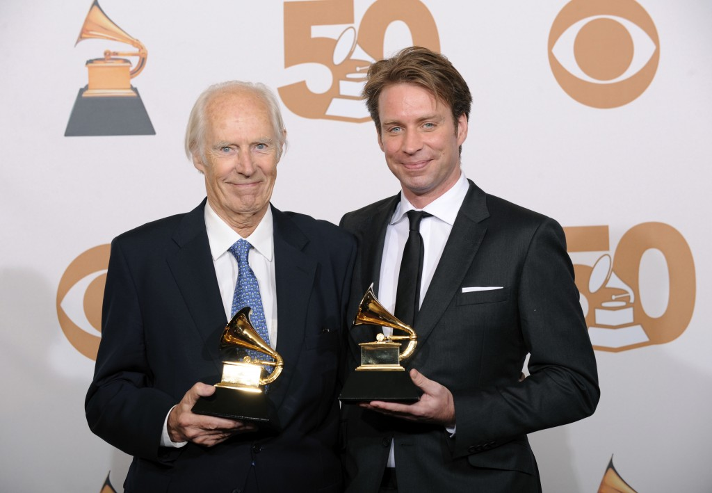 FILE - In this Feb. 10, 2008 file photo, Beatles producer George Martin, left, and his son Giles Martin appear in the press room with their awards for