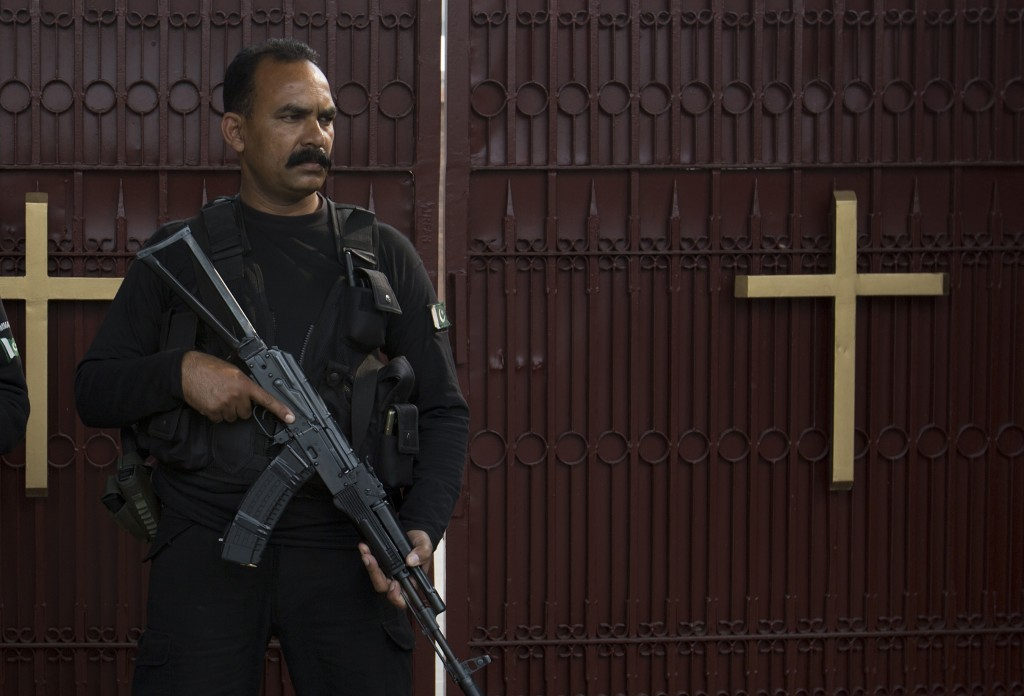 In this Oct. 31, 2018, photo, a Pakistani police commando stands guard outside St. Thomas' church in Islamabad, Pakistan, Oct. 31, 2018. The uproar su