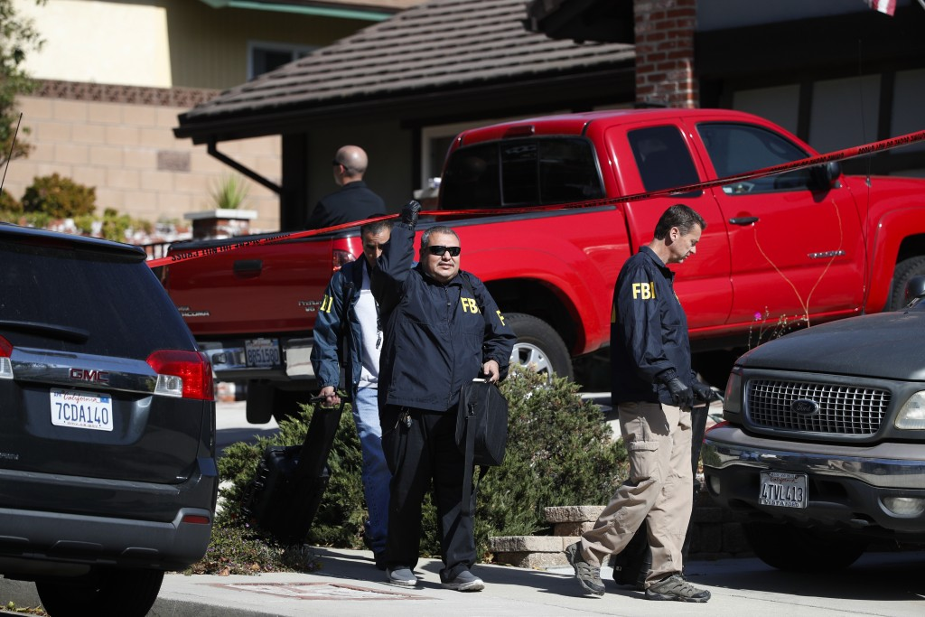 FBI agents leave the house of shooting suspect David Ian Long in Newbury Park, Calif., on Thursday, Nov. 8, 2018. Authorities said the former Marine o