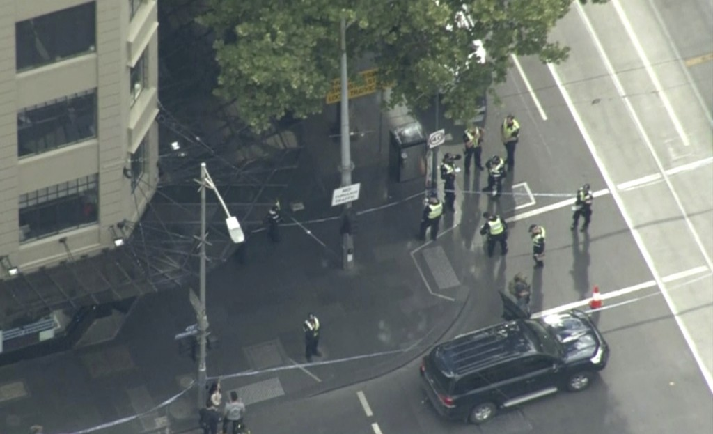 This image made from video shows police on street corner after a shooting in Melbourne, Australia, Friday, Nov. 9, 2018. Police shot a knife-wielding