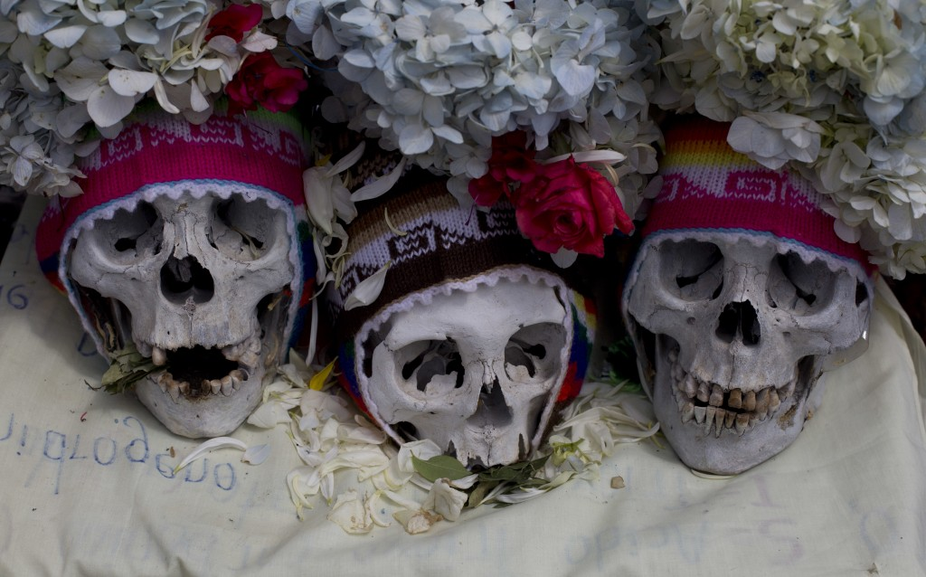 Decorated humans skulls are displayed at the General Cemetery marking the annual Natitas Festival in La Paz, Bolivia, Thursday, Nov. 8, 2018. Celebrat...