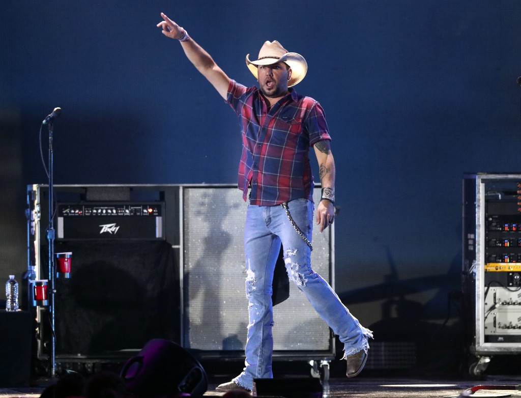 """FILE - In this Sept. 21, 2018 file photo, Jason Aldean performs at the 2018 iHeartRadio Music Festival in Las Vegas. Aldean's """"Drowns the Whiskey"""" fea..."""