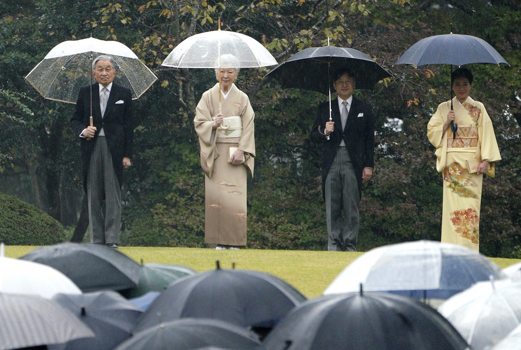 In this Nov. 9, 2018, file photo, Japan's Emperor Akihito, left, Empress Michiko, second from left, Crown Prince Naruhito, second from right, and Crow...