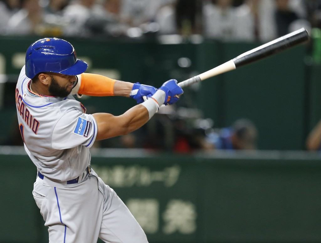 MLB All-Star shortstop Amed Rosario of the New York Mets hits a solo home-run off All Japan's starting pitcher Takayuki Kishi in the third inning of G