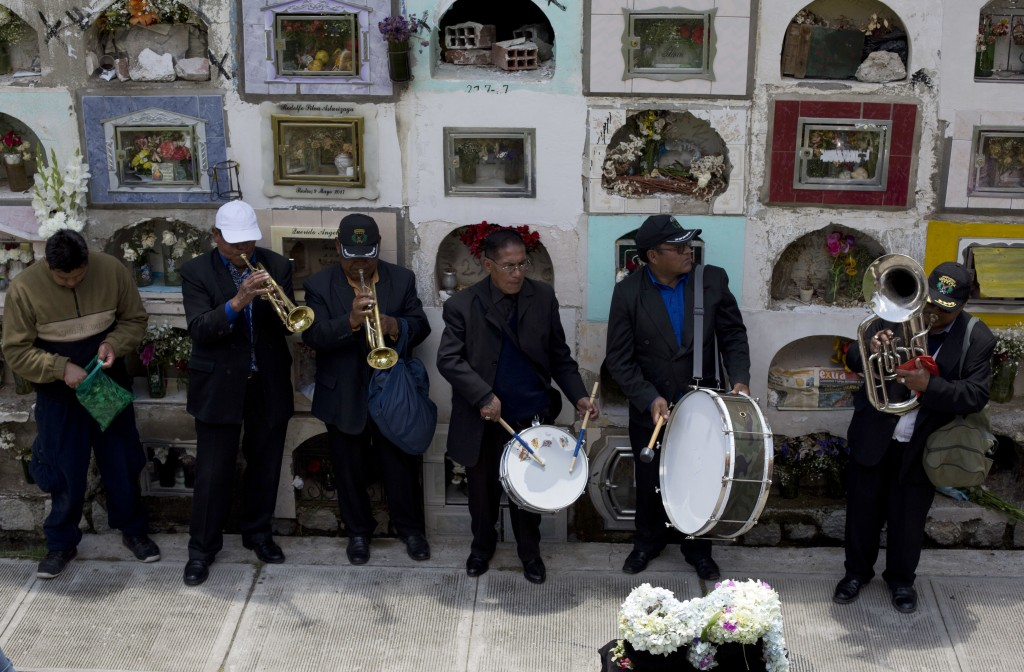 "Musicians serenade human skull or ""natitas"" at the General cemetery, during the Natitas Festival, in La Paz, Bolivia, Thursday, Nov. 8, 2018. Celebrat..."