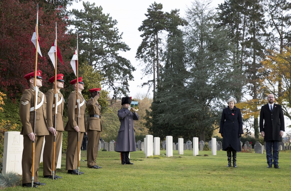 British Prime Minister Theresa May, second right, and Belgian Prime Minister Charles Michel, right, prepare to lay wreaths at the graves of British Wo...