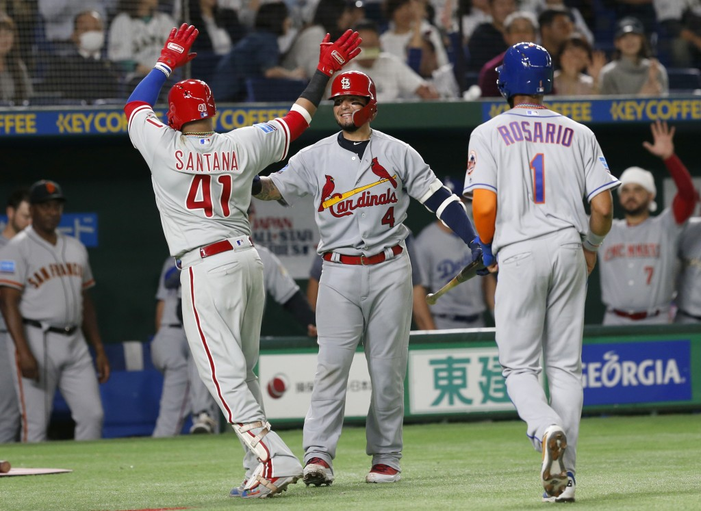 MLB All-Star first baseman Carlos Santana (41) of the Philadelphia Phillies celebrates with teammates Yadier Molina (4) of the St. Louis Cardinals and