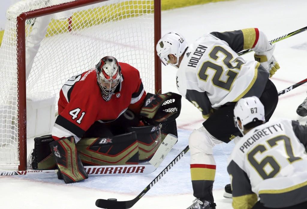 Vegas Golden Knights defenseman Nick Holden (22) scores on Ottawa Senators goaltender Craig Anderson (41) as Vegas Golden Knights left wing Max Pacior