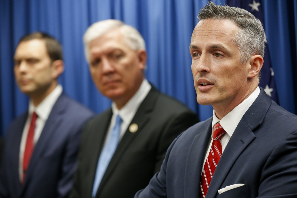 Tim Garrison, right, United States Attorney for the Western District of Missouri, speaks during a press conference on Thursday, Nov. 8, 2018 in Spring