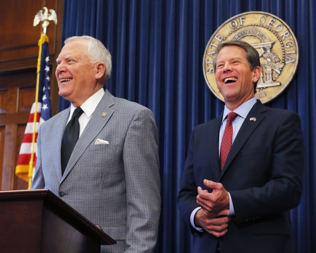 Republican Brian Kemp, right, and Georgia Gov. Nathan Deal hold a news conference in the Governor's ceremonial office at the Capitol on Thursday, Nov.