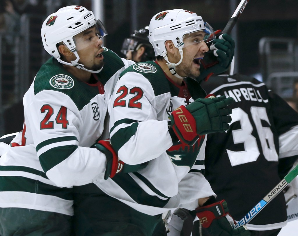 Minnesota Wild right wing Nino Niederreiter (22), of Switzerland, celebrates his goal with defenseman Matt Dumba (24) during the first period of an NH