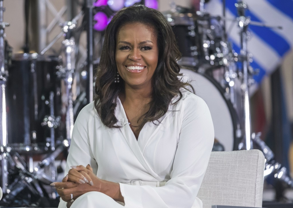"""FILE - In this Oct. 11, 2018, file photo, Michelle Obama participates in the International Day of the Girl on NBC's """"Today"""" show in New York. (Photo b..."""