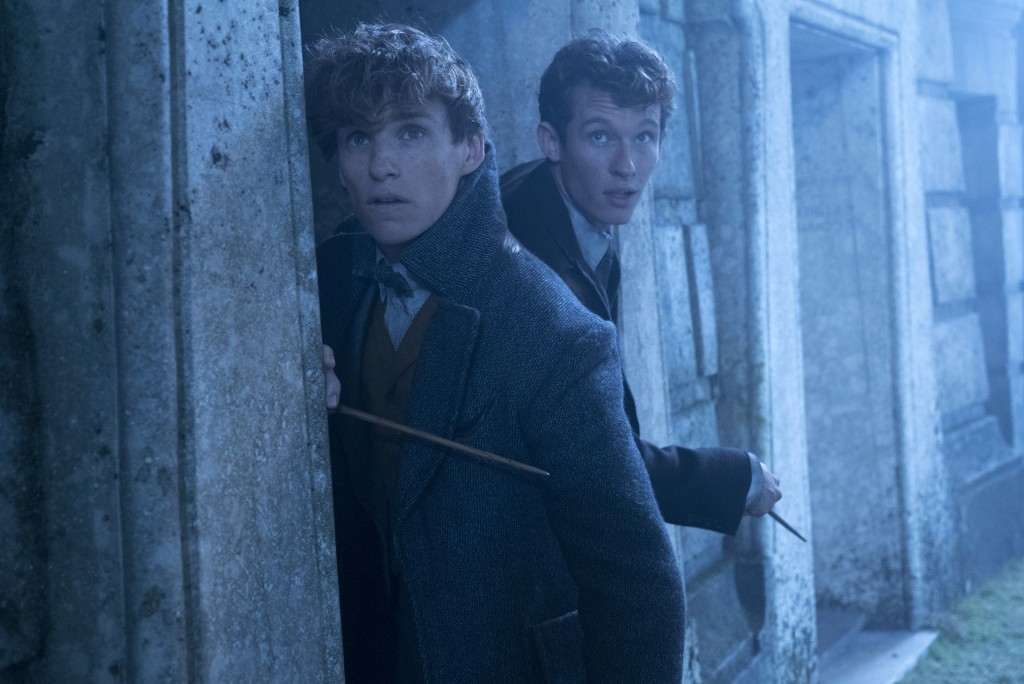 """This image released by Warner Bros. Pictures shows Eddie Redmayne, left and Callum Turner in a scene from """"Fantastic Beasts: The Crimes of Grindelwald..."""