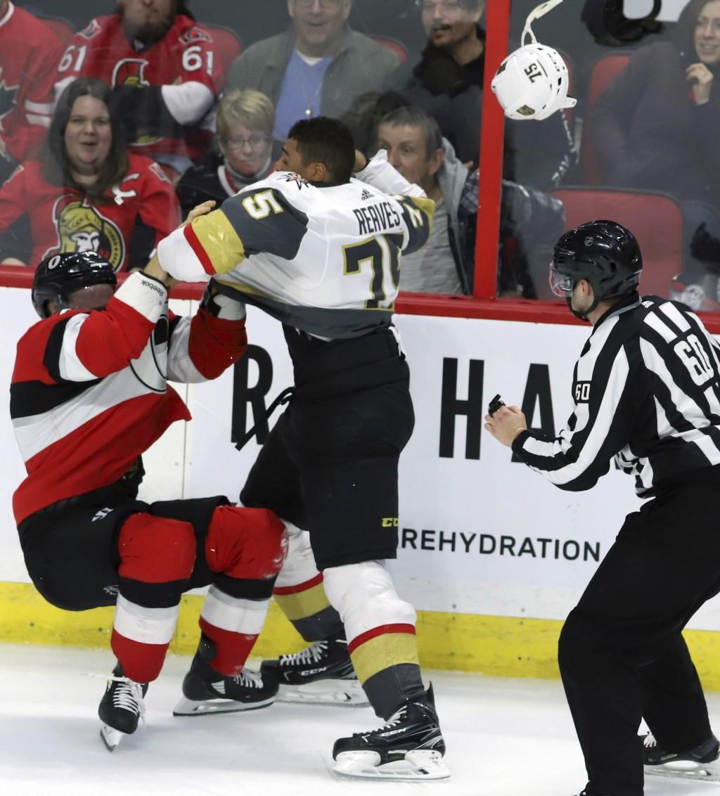 Ottawa Senators defenseman Mark Borowiecki (74) and Vegas Golden Knights right wing Ryan Reaves (75) fight during the second period of an NHL hockey g