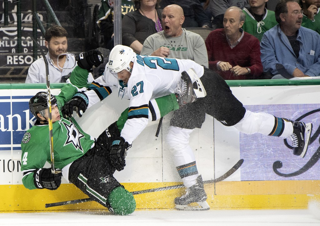 Dallas Stars defenseman Miro Heiskanen (4), of Finland, and San Jose Sharks right wing Joonas Donskoi (27), of Finland, tumble to the ice during the s