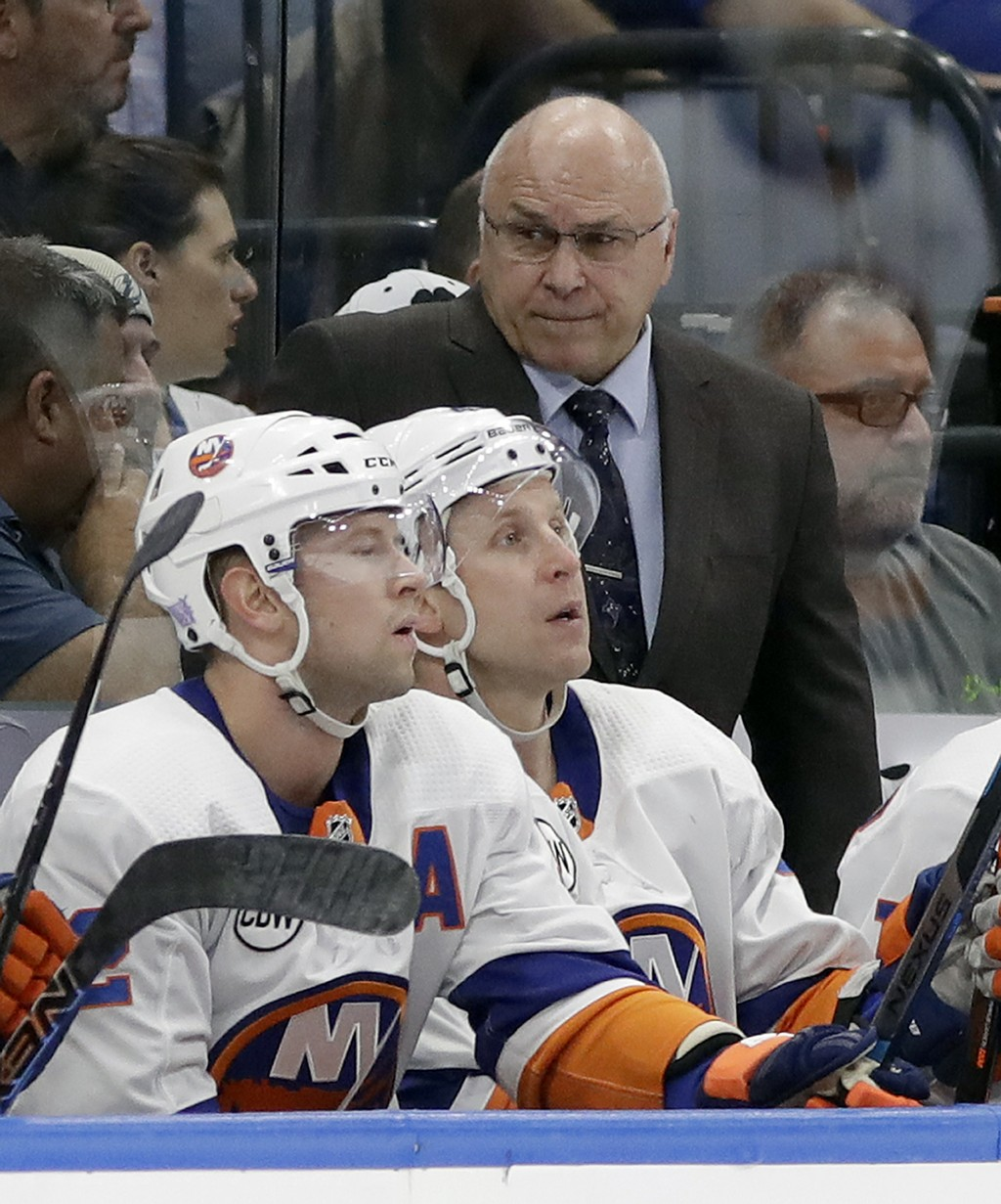 New York Islanders coach Barry Trotz talks to players during the first period of an NHL hockey game against the Tampa Bay Lightning on Thursday, Nov.