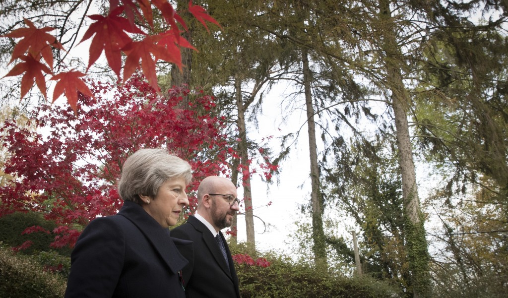 British Prime Minister Theresa May, left, and Belgian Prime Minister Charles Michel walk at the St. Symphorien cemetery in Mons, Belgium, Friday, Nov.