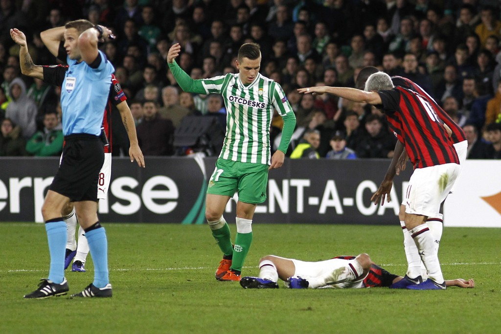 AC Milan's Mateo Musacchio is seen injured on the ground during the Europa League, Group F soccer match between AC Milan and Betis, at the Benito Vill