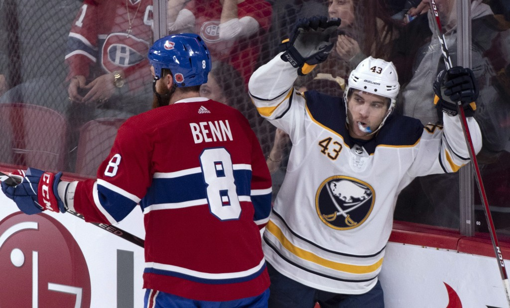 Montreal Canadiens' Jordie Benn skates past Buffalo Sabres' Conor Sheary as he celebrates his goal during the first period of an NHL hockey game Thurs
