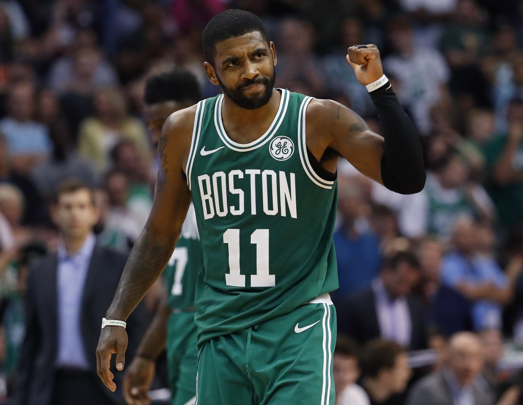 Boston Celtics guard Kyrie Irving celebrates a basket during the second half of the team's NBA basketball game against the Phoenix Suns, Thursday, Nov
