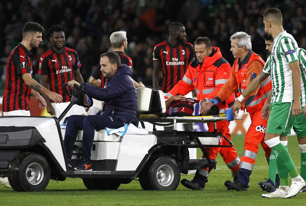 AC Milan's Mateo Musacchio is taken on a stretcher after being injured during the Europa League, Group F soccer match between AC Milan and Betis, at t