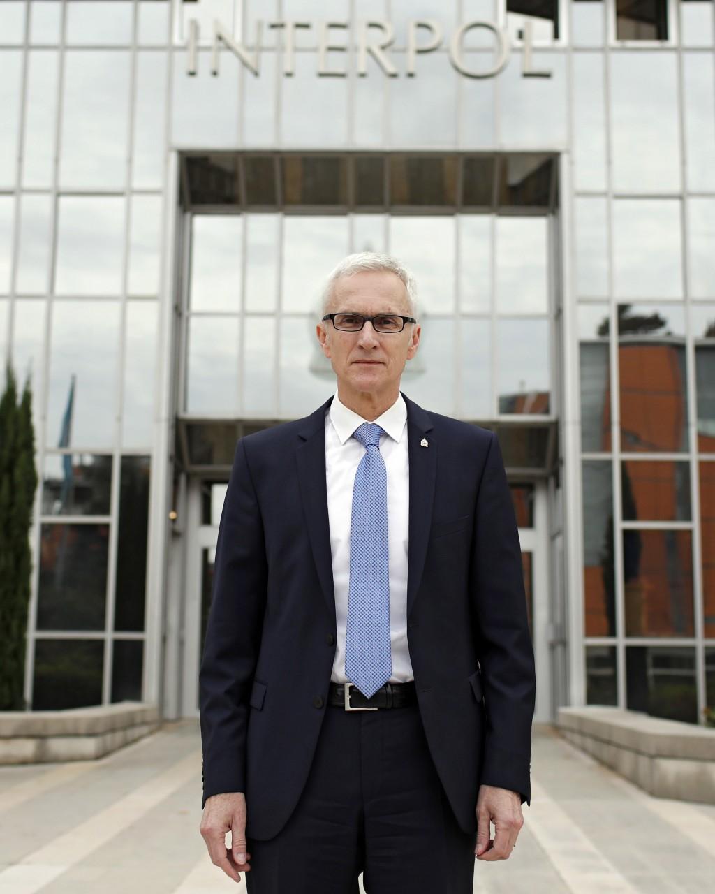 Interpol Secretary General Jurgen Stock poses a the international police agency in Lyon, central France, Thursday, Nov.8, 2018. (AP Photo/Laurent Cipr