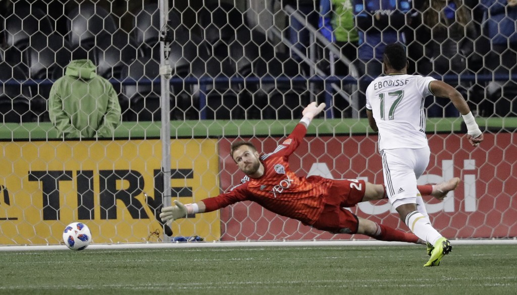 Seattle Sounders goalkeeper Stefan Frei, left can't get to the ball on a goal by Portland Timbers midfielder Sebastian Blanco, not seen, as Timbers' J