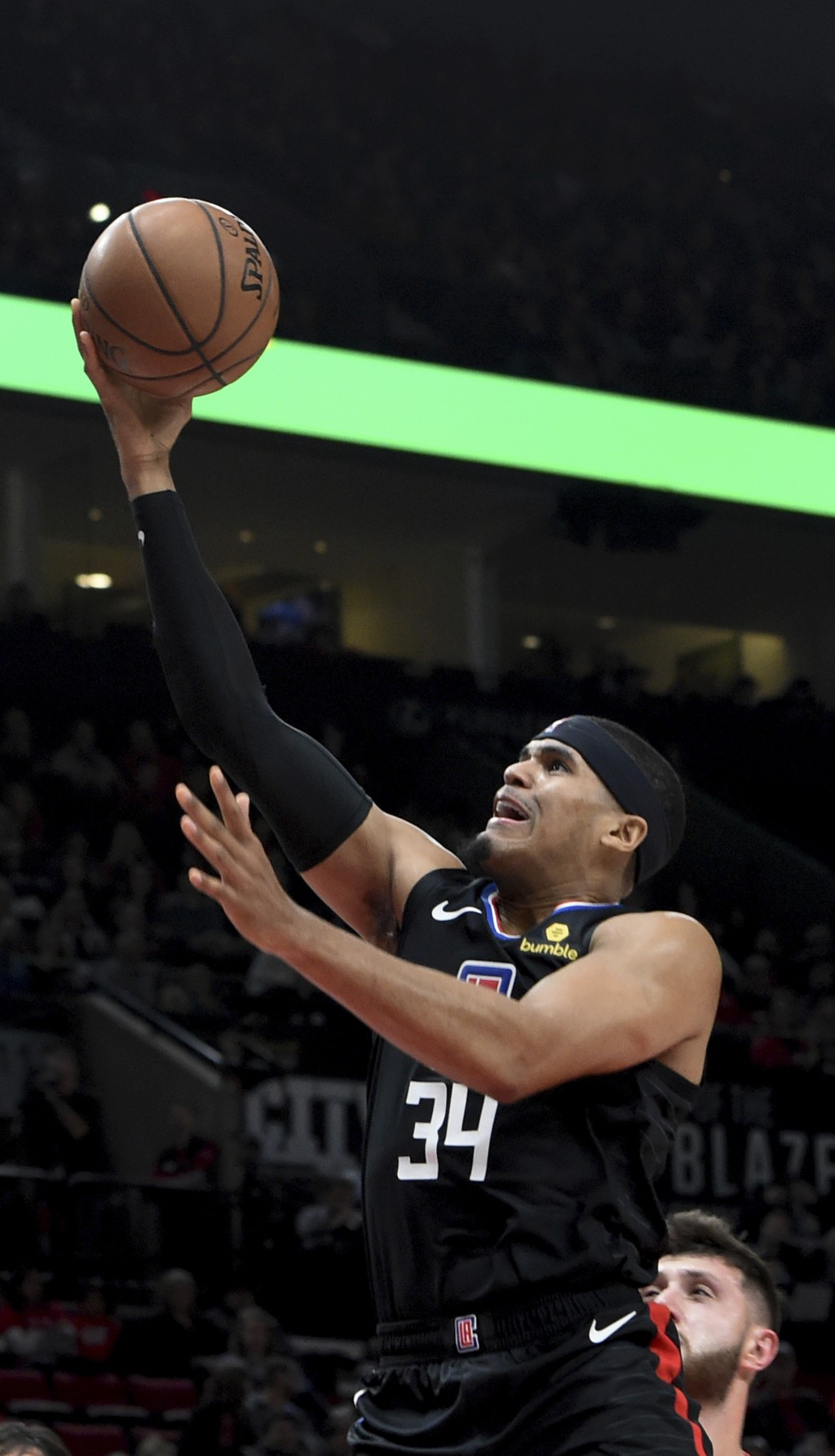 Los Angeles Clippers forward Tobias Harris, left, drives to the basket past Portland Trail Blazers center Jusuf Nurkic, right, during the first half o