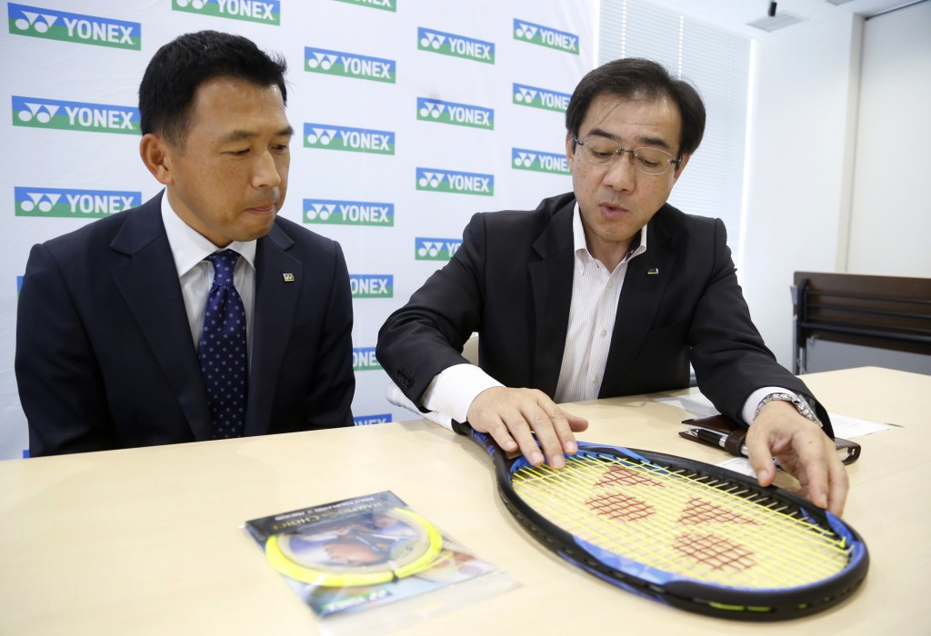In this Nov. 5, 2018, photo, Wataru Hirokawa, right, executive office at Yonex's global marketing, and Nori Shimojo in charge of tennis player service
