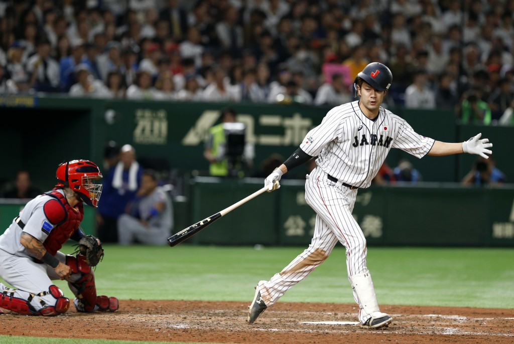 All Japan's Yuki Yanagita is struck out swinging off MLB All-Star pitcher Collin McHugh of the Houston Astros in the seventh inning of Game 1 of their